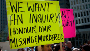 On fluroescent yellow bulletin board, in black letters, it is written - 'We want an inquiry! Honour our Missing & Murdered.